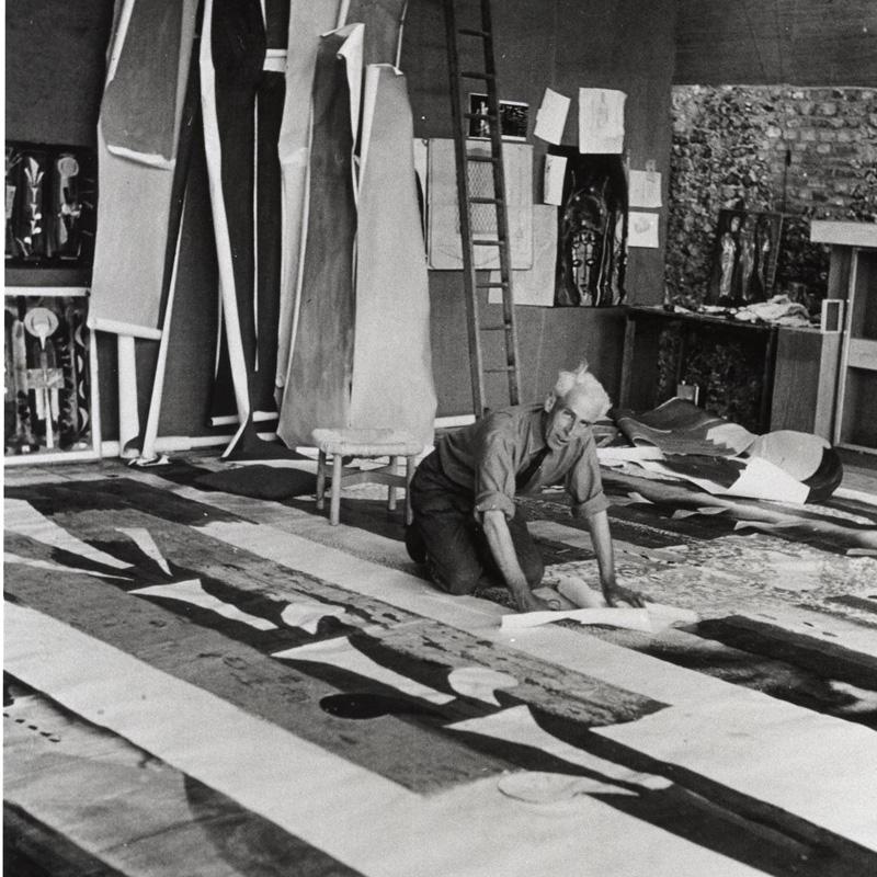 John Piper in his studio working on a cartoon - web